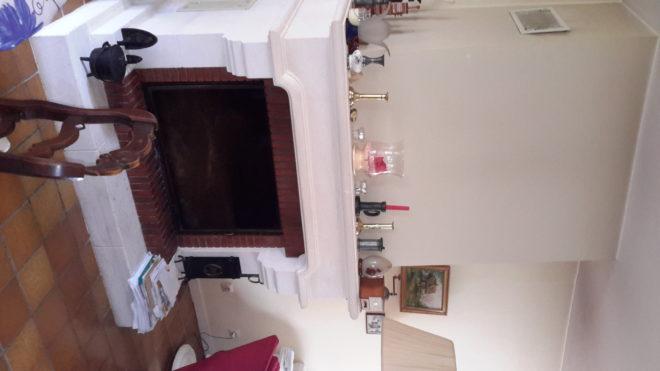 cheminée à foyer fermé avec porte ouvrante et totalement escamotable